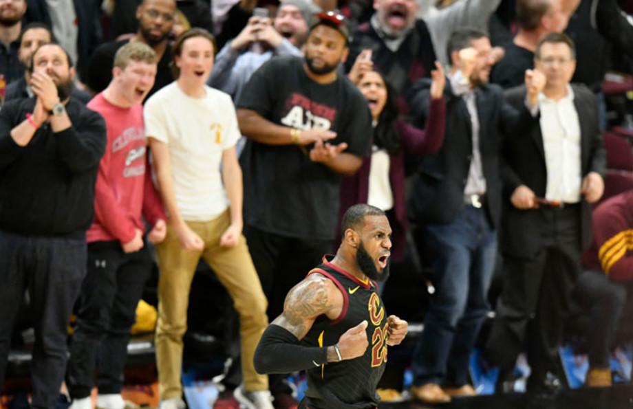 LeBron James celebrates a three-pointer against the Kings.
