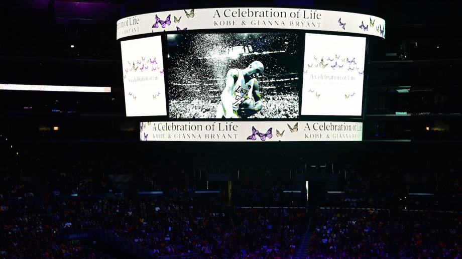 "A screen shows photos during the ""Celebration of Life for Kobe and Gianna Bryant"" service"