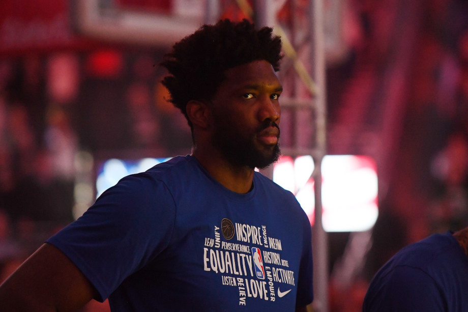 Joel Embiid #21 of the Philadelphia 76ers stands for the National Anthem prior to a game.