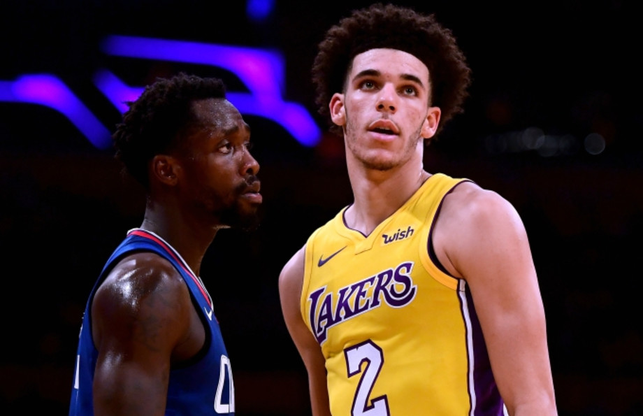 Patrick Beverley talks trash to Lonzo Ball.