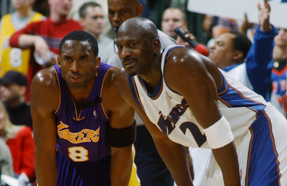 Kobe Bryant #8 of the Los Angeles Lakers rests next to Michael Jordan