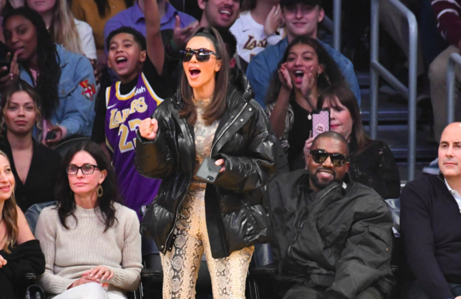 Kim Kardashian and Kanye West attend a basketball game