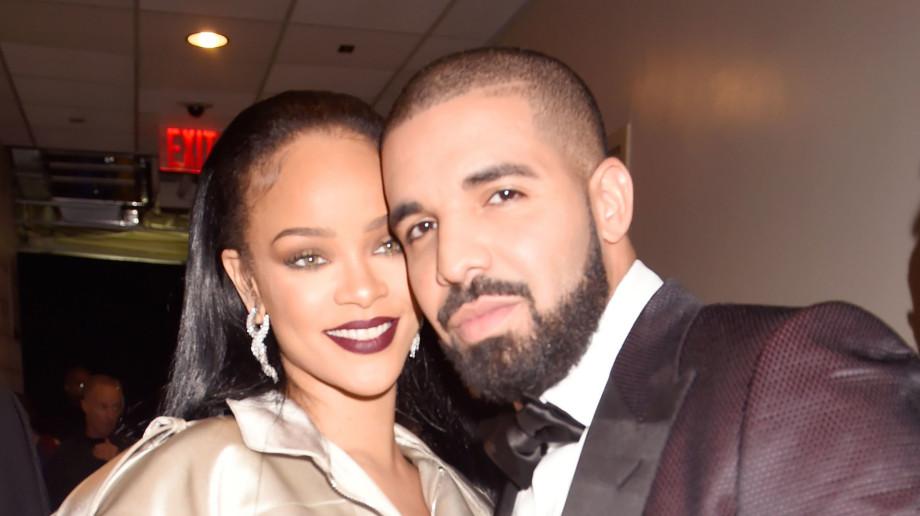 Rihanna and Drake pose backstage