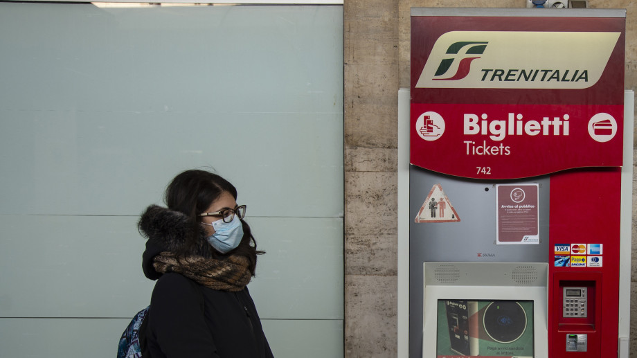 Train passenger with masks during sanitary checks on March 08, 2020