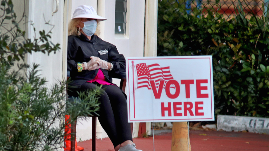 A poll worker at the First Baptist Church voting site in Hollywood, Fla.