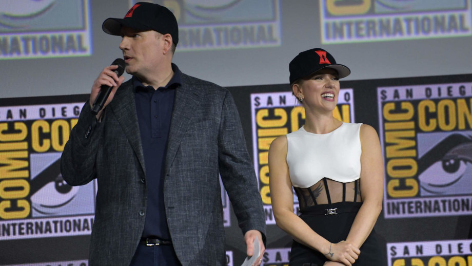 Kevin Feige and Scarlett Johansson speak on stage for the Marvel panel of Comic Con.
