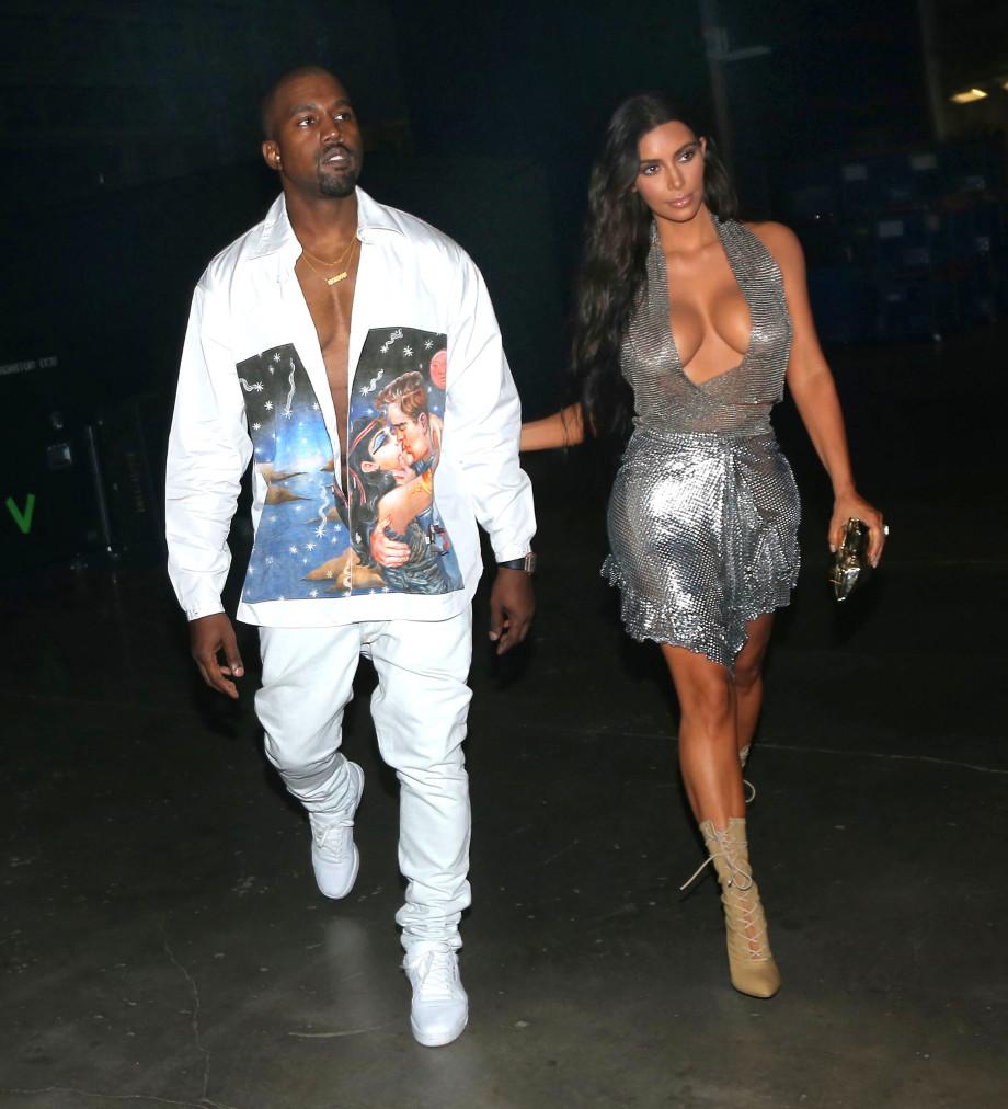 Kanye in a Prada shirt with Kim in Miami
