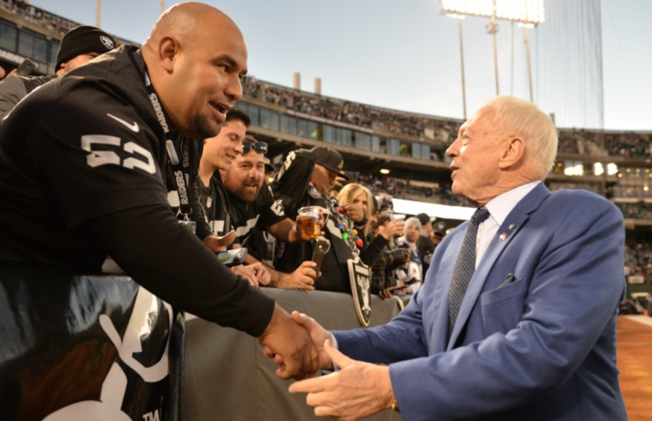Jerry Jones shakes hands with Raiders fans.
