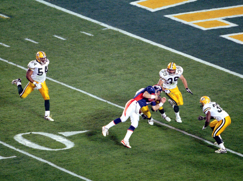 John Elway about to get tackled at the 4