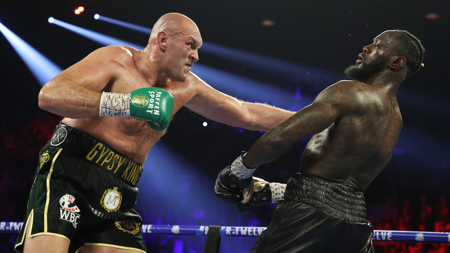 Tyson Fury punches Deontay Wilder