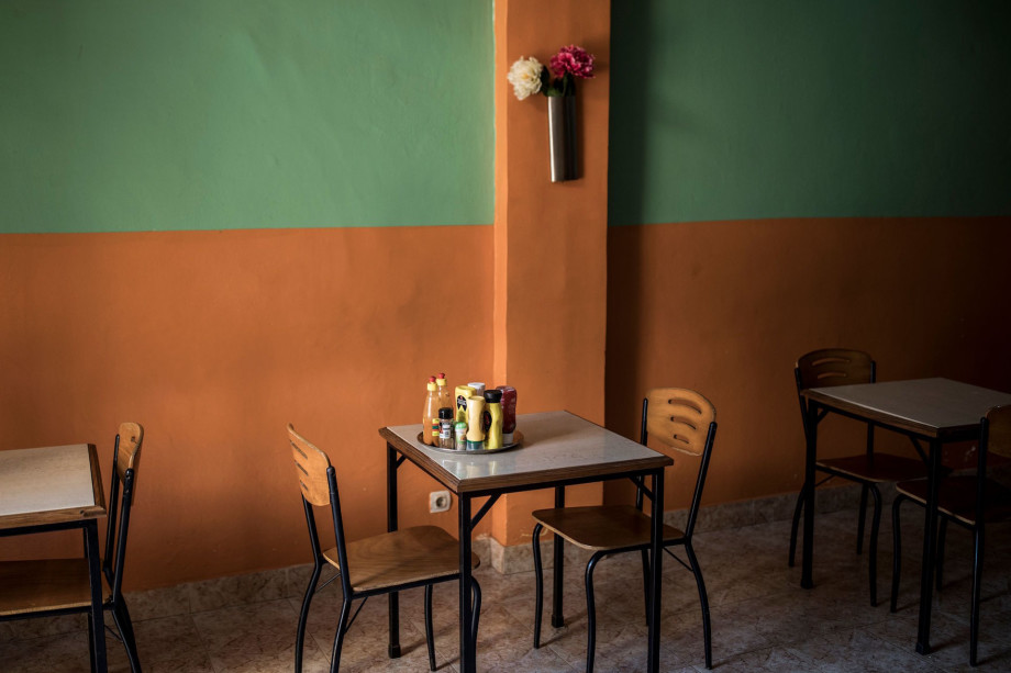 """Condiments sit on a table in a restaurant in """"Bissau-Velho"""", Bissau's old city."""