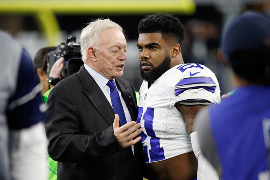 Dallas Cowboys owner Jerry Jones talks with Ezekiel Elliott