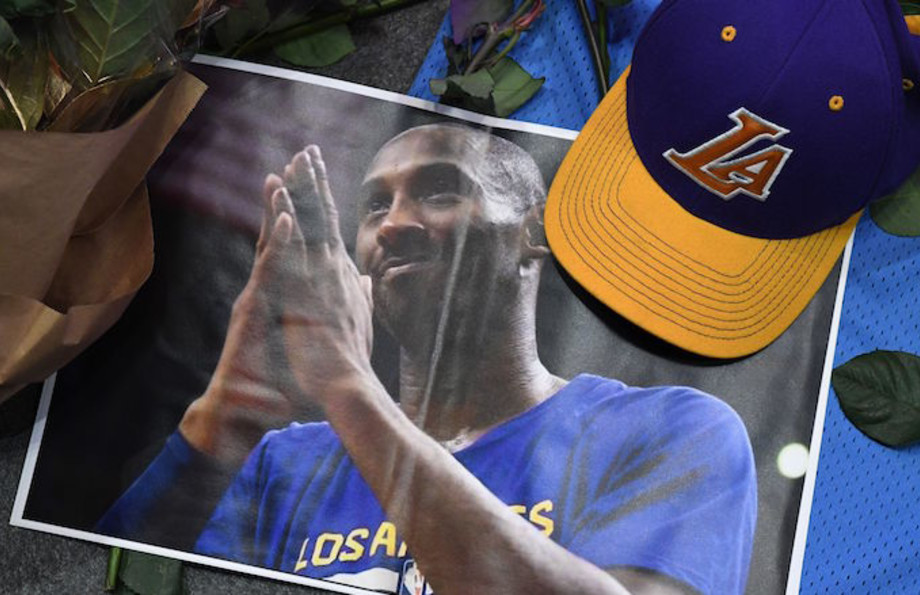 A photo, hat and flowers placed at makeshift memorial as fans mourn the death of Kobe Bryant.