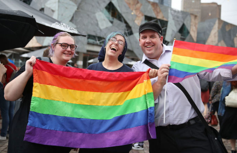 People celebrate Australia officially legalizing same-sex marriage.