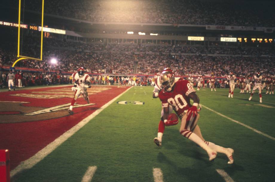 Jerry Rice of the 49ers carrying ball to end zone during Super Bowl XXIII