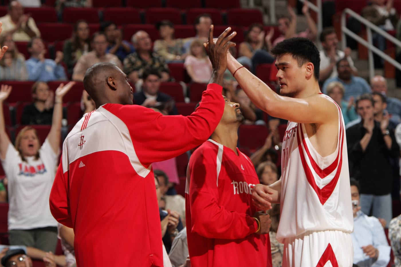 This is a photo of Dikembe Mutombo and Yao Ming