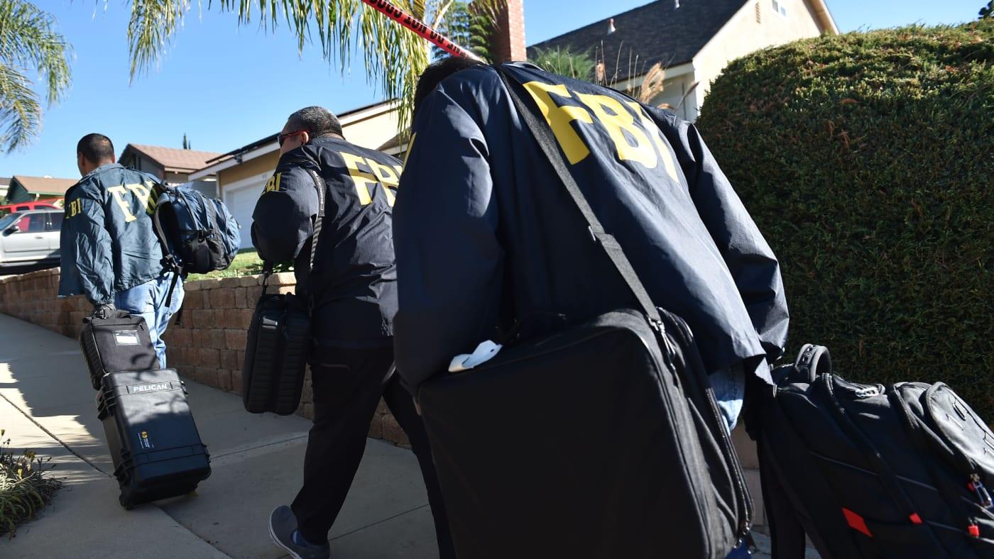 FBI investigators arrive at the home of suspected nightclub shooter Ian David Long.
