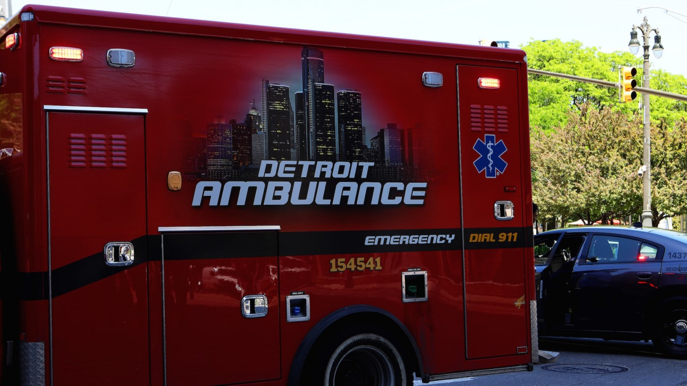 A Detroit Ambulance makes its way through downtown in Detroit