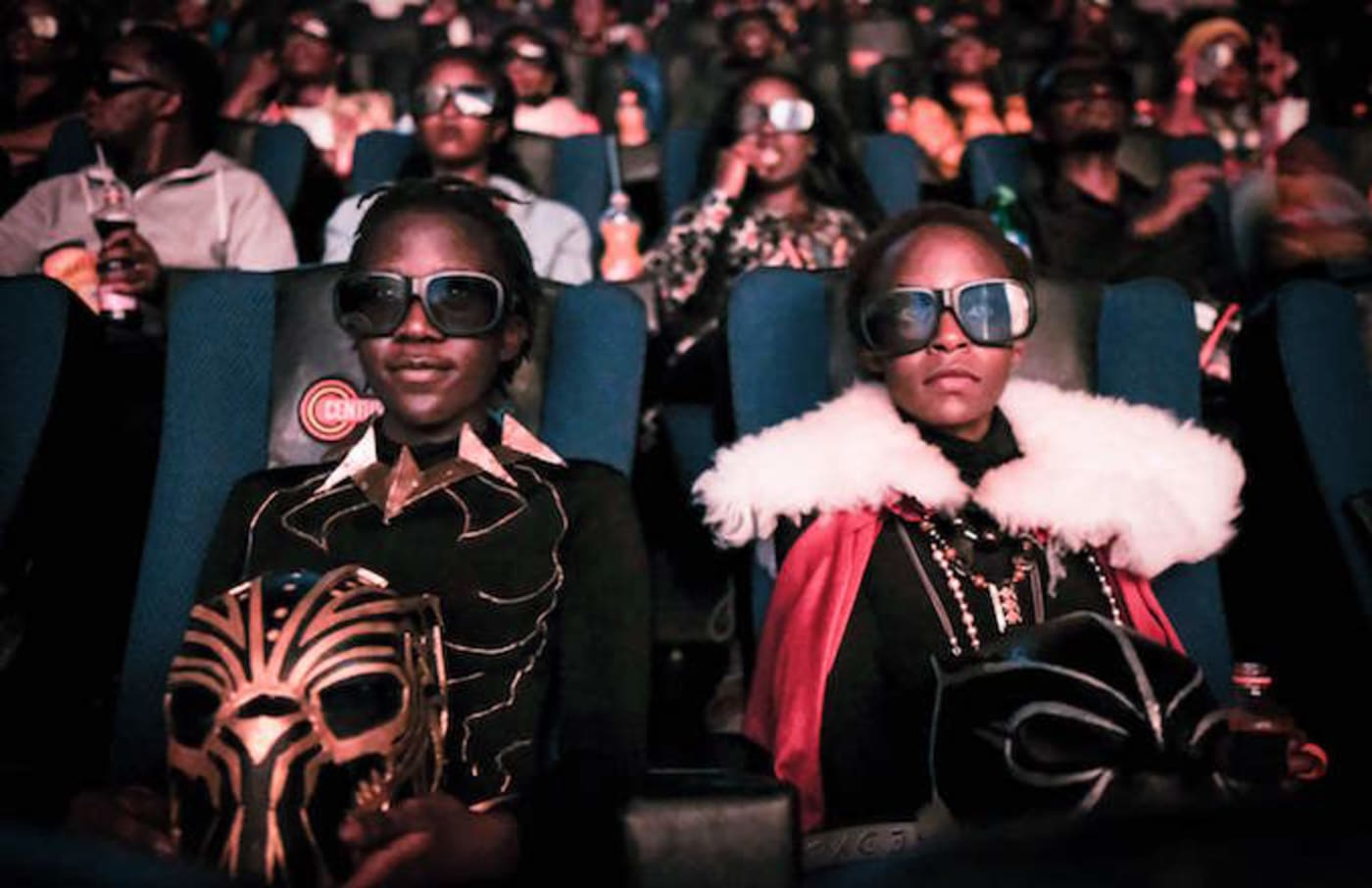 Cosplayers watching the film 'Black Panther' in 3D.