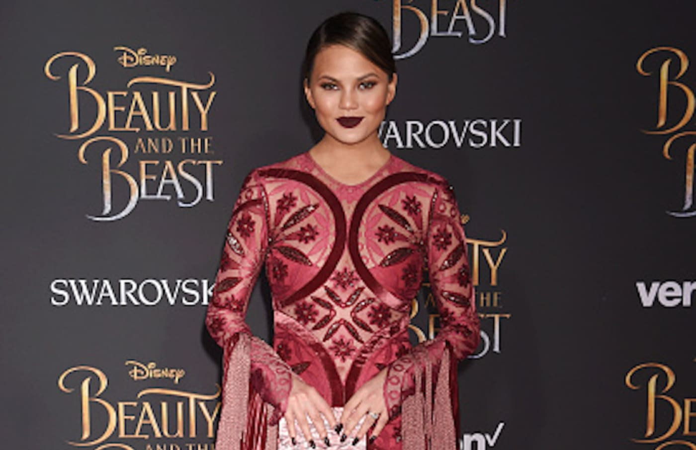 Chrissy Teigen arrives at the Premiere Of Disney's 'Beauty And The Beast'