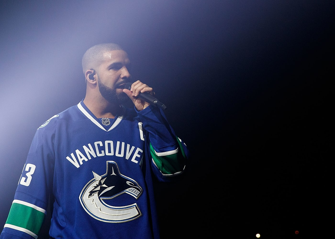 Drake performing in Vancouver wearing Canucks jersey