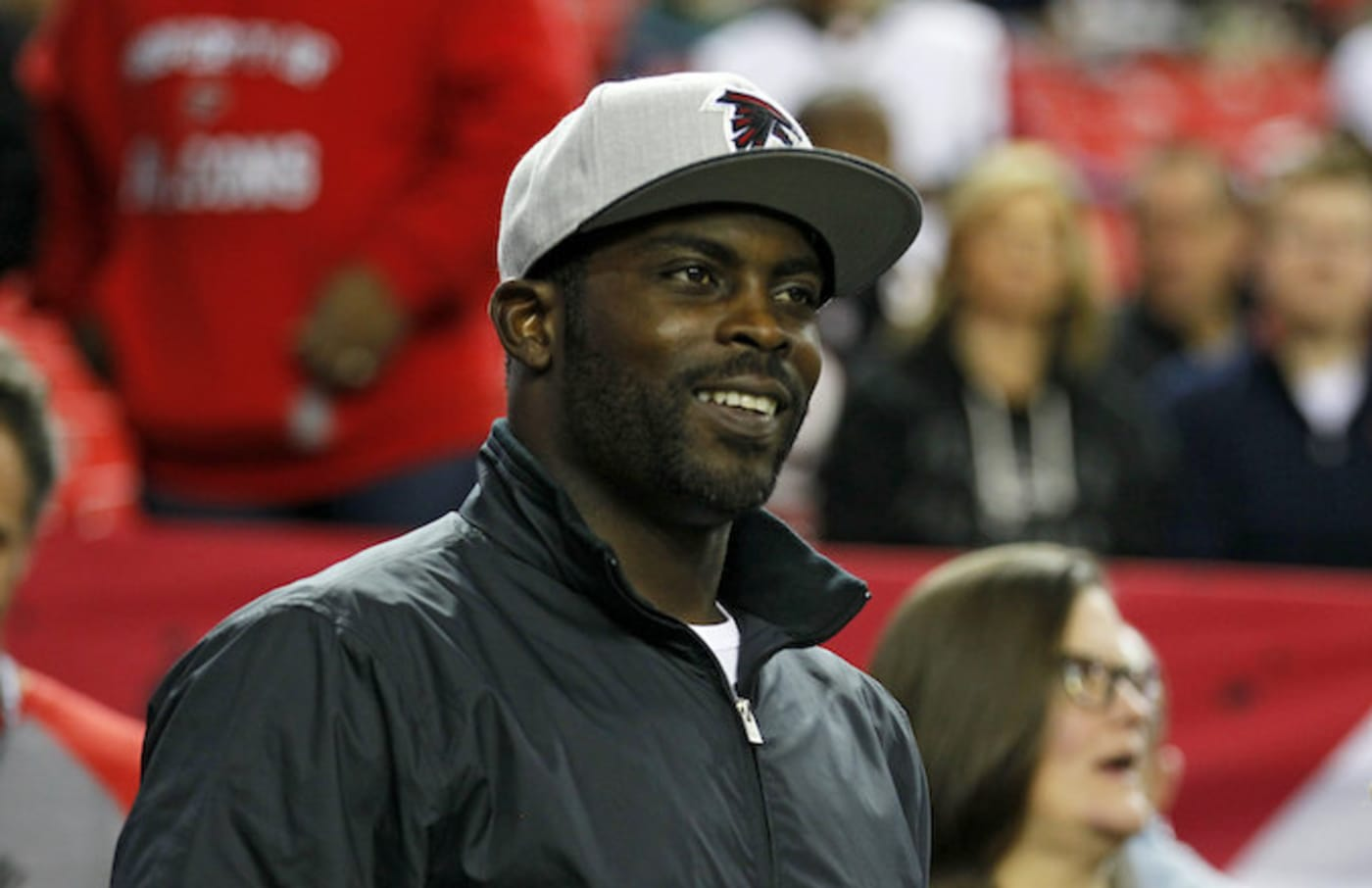 Michael Vick walks onto the sidelines prior to an NFL football game.