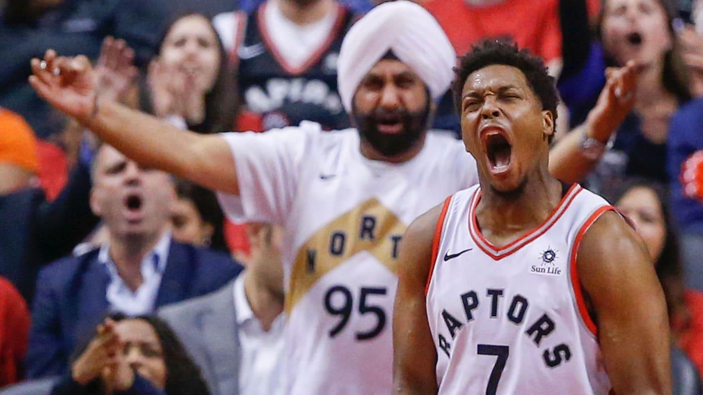 Raptors superfan Nav Bhatia cheers on Raptors star Kyle Lowry at Scotiabank Centre