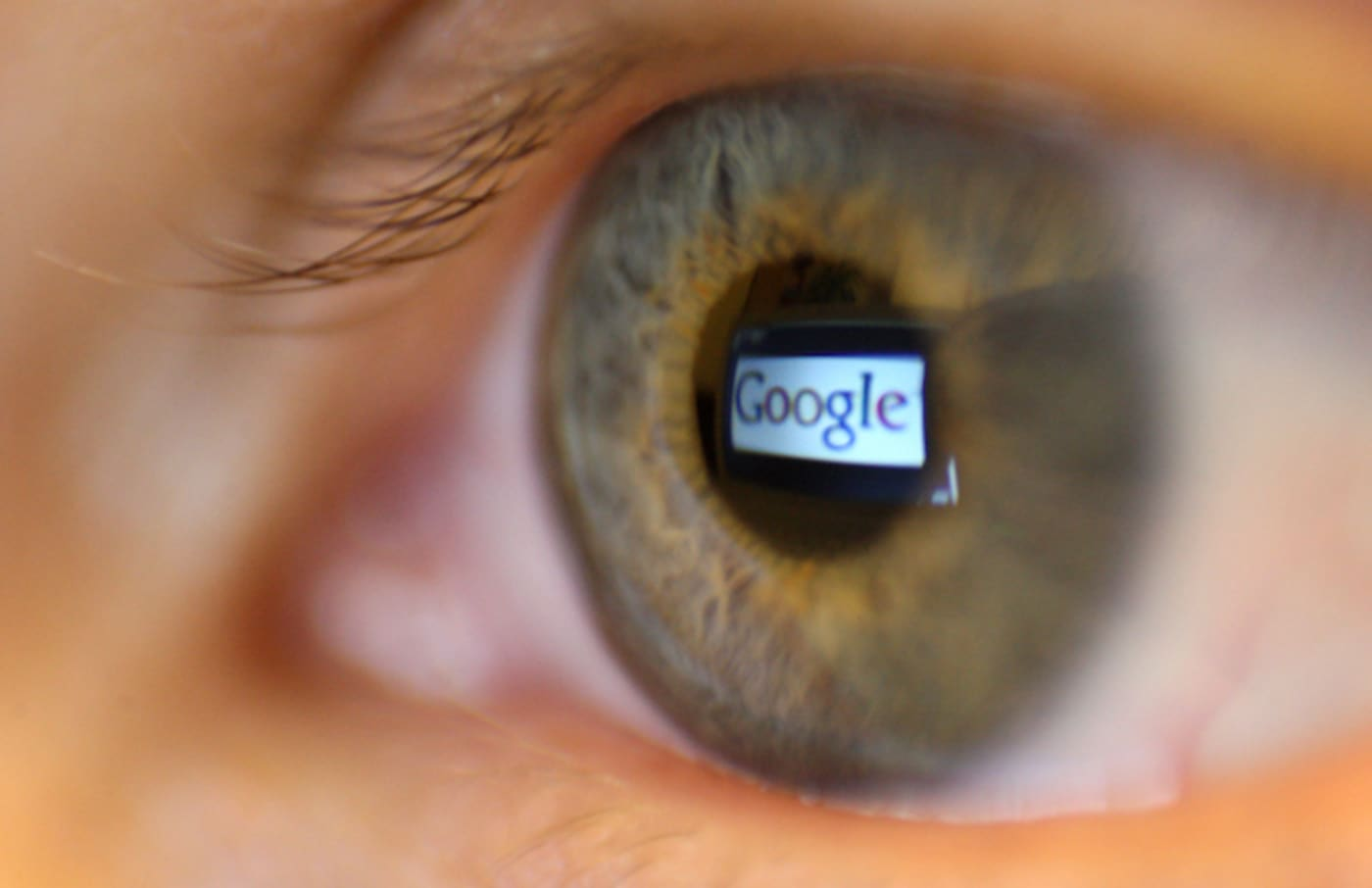 Google seen reflected in a person's eye.