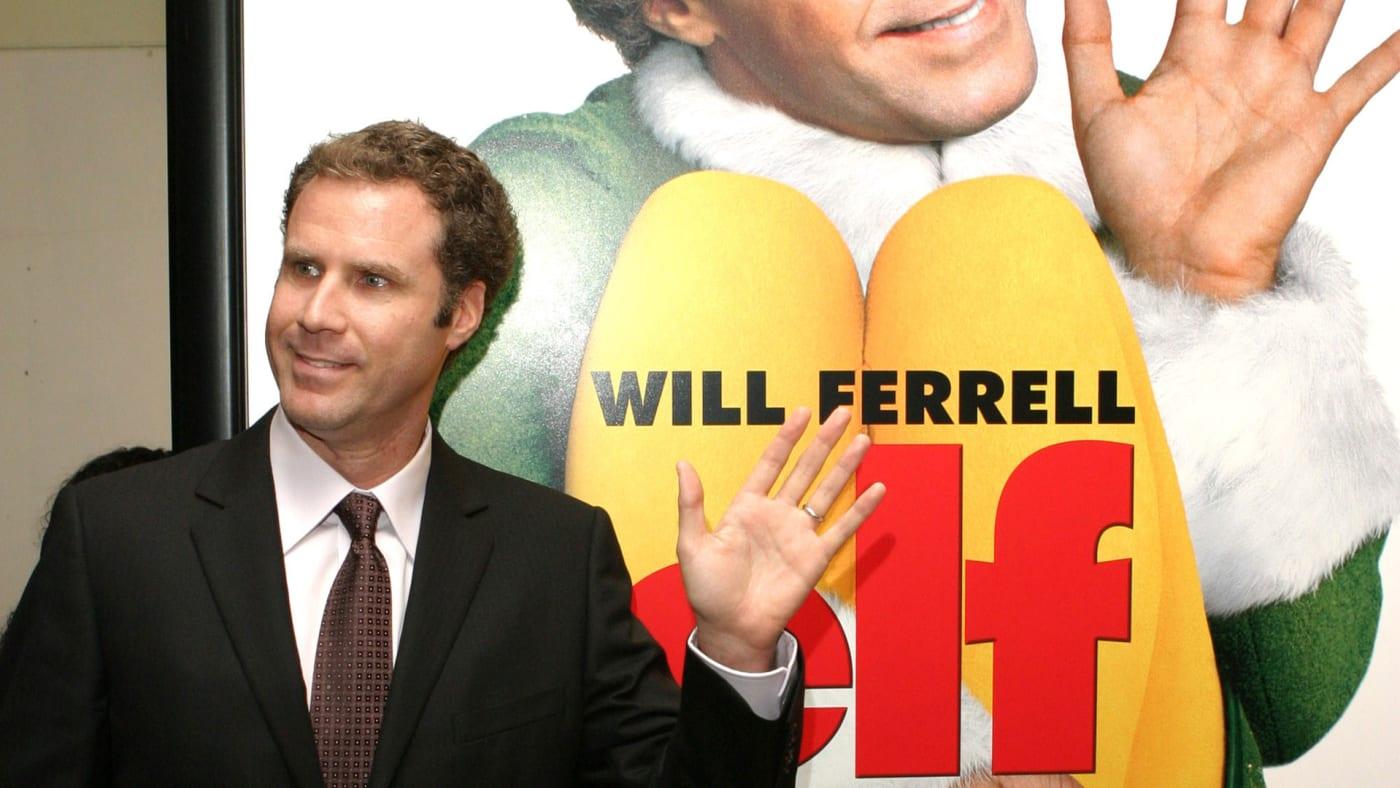 Will Ferrell poses alongside the poster for 'Elf'.