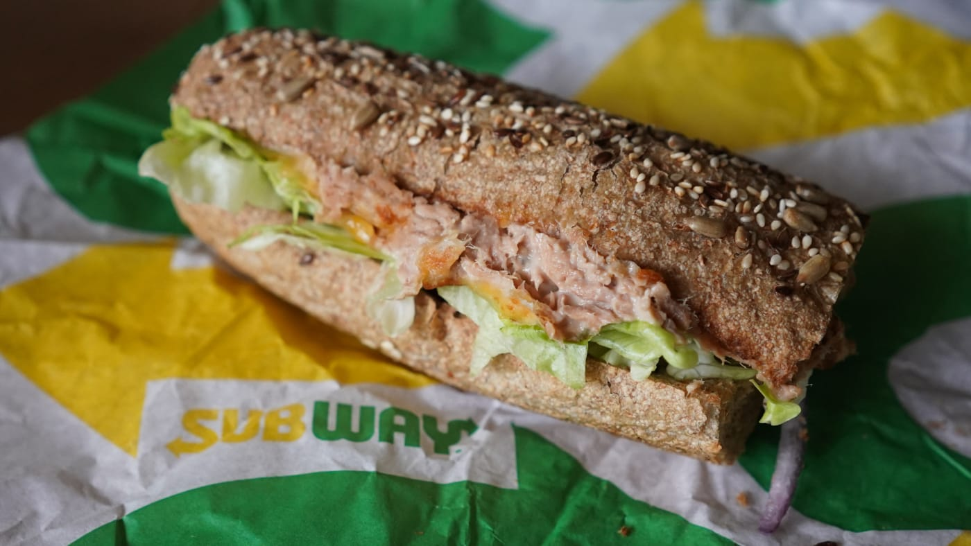 """A """"Tuna Sandwich"""" from the fast food chain """"Subway"""" lies on a table."""