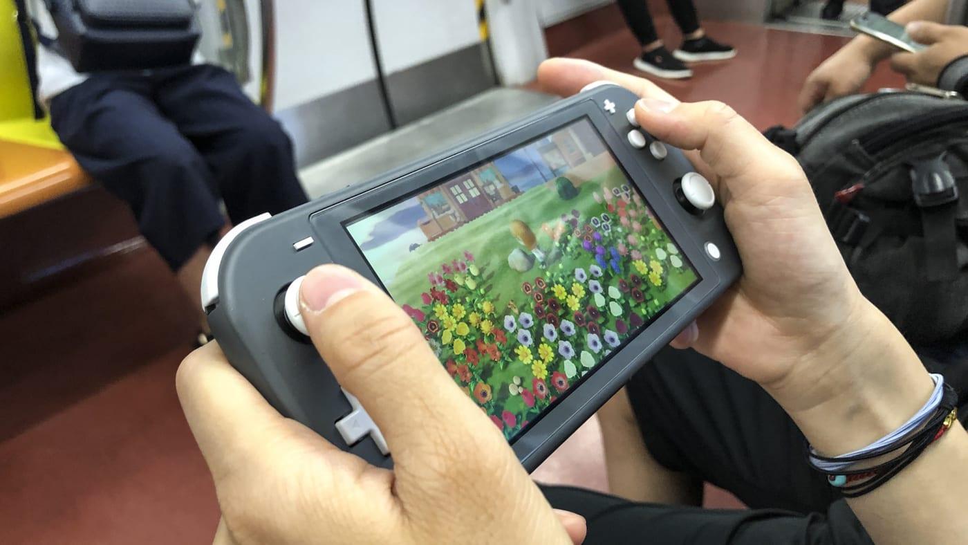 A passenger uses a Nintendo Switch