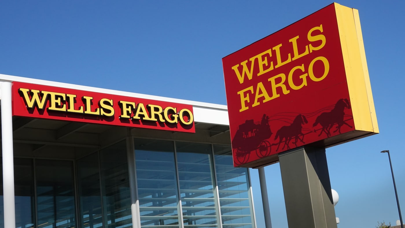 A sign hangs outside of a Wells Fargo bank branch