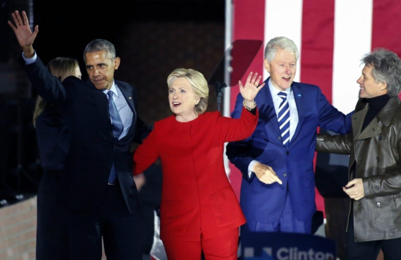 Barack Obama and Hillary Clinton at a rally.