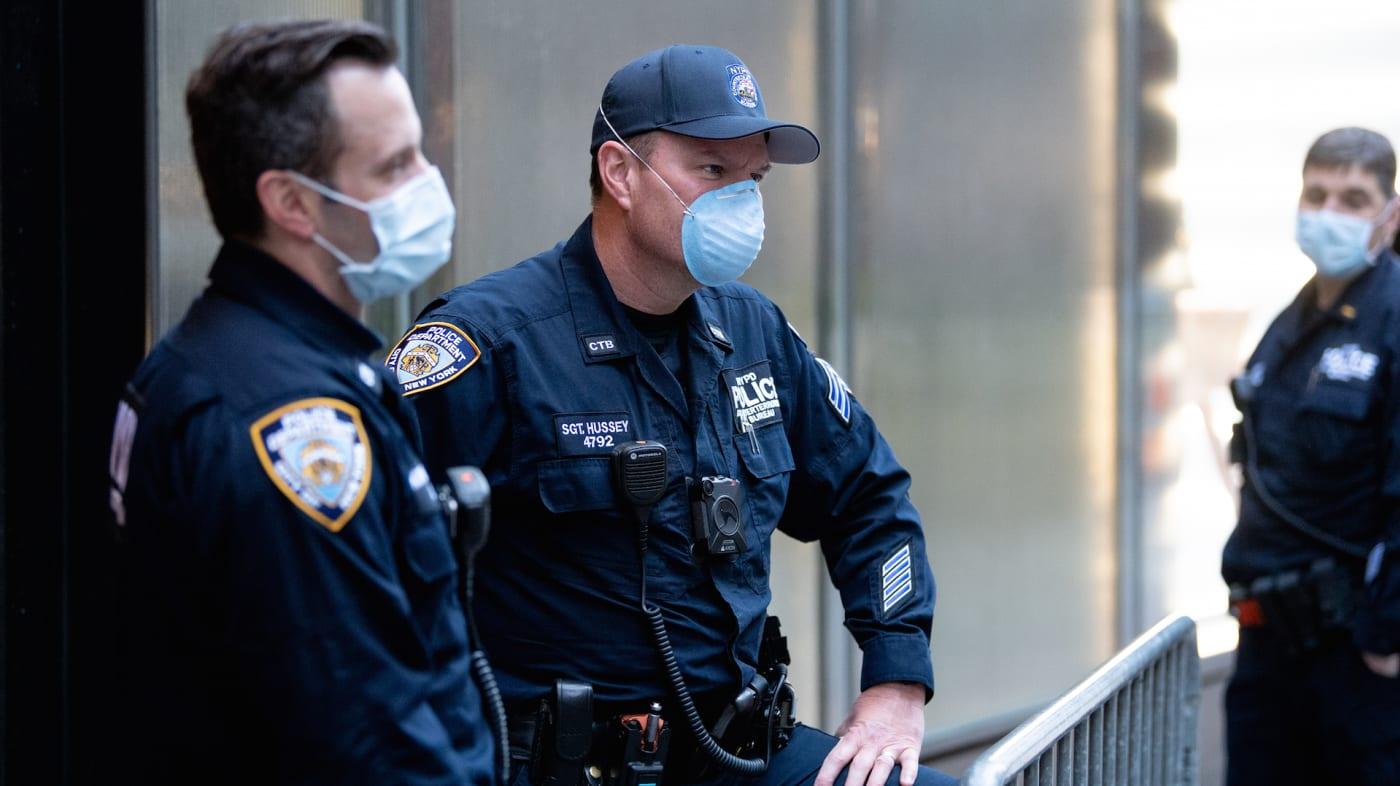 Police Officers wear Surgical Masks