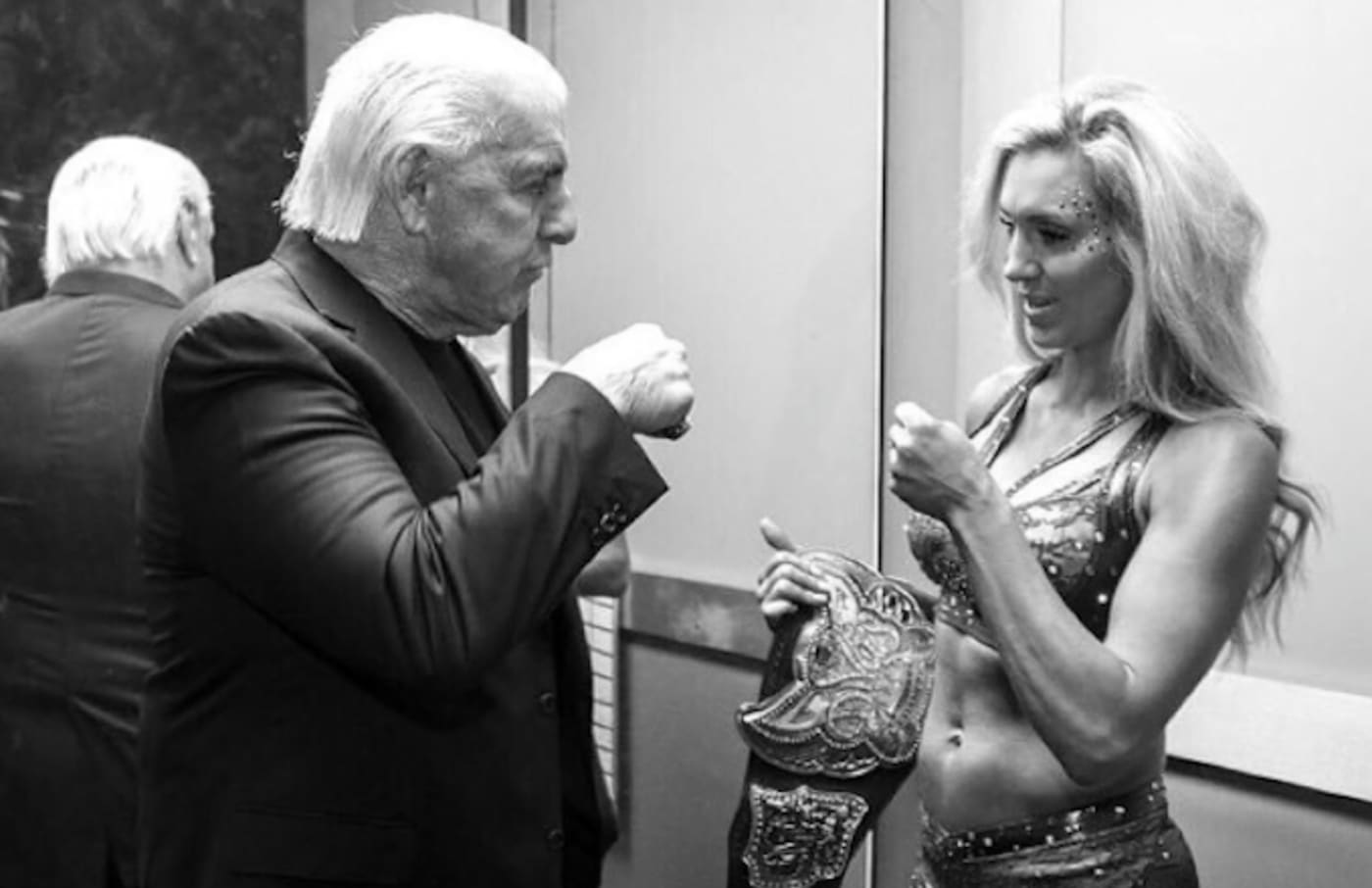 Charlotte Flair shares a photo of her and father Ric on Instagram.