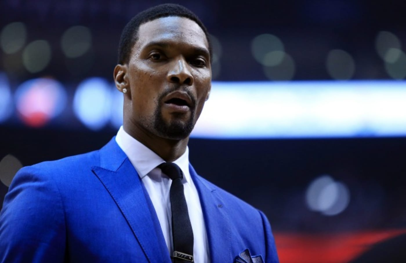 Chris Bosh sits on the bench during a game last season.