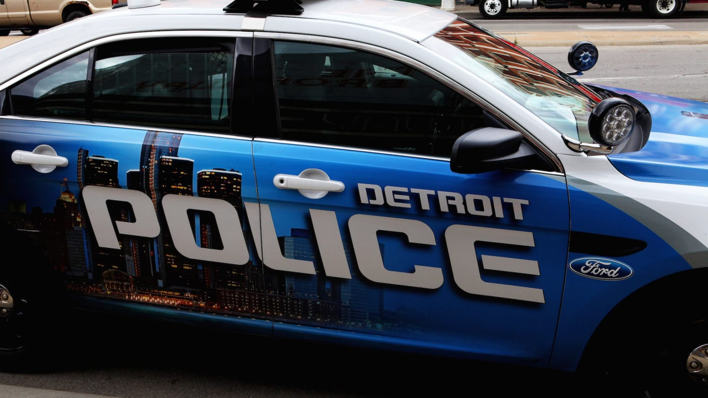 A Detroit police car sits on a downtown street