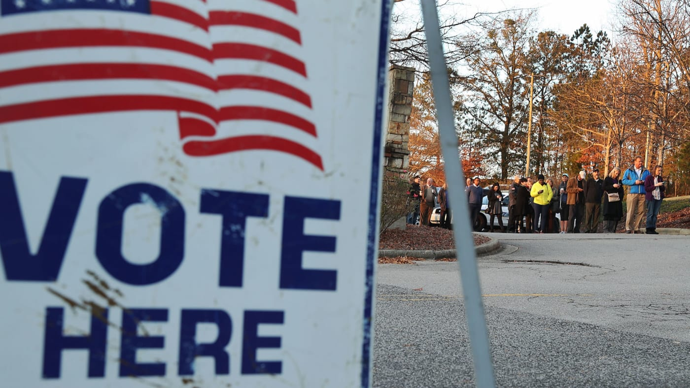 Voters wait in line to cast ballot at polling station setup in St Thomas Episcopal Church.
