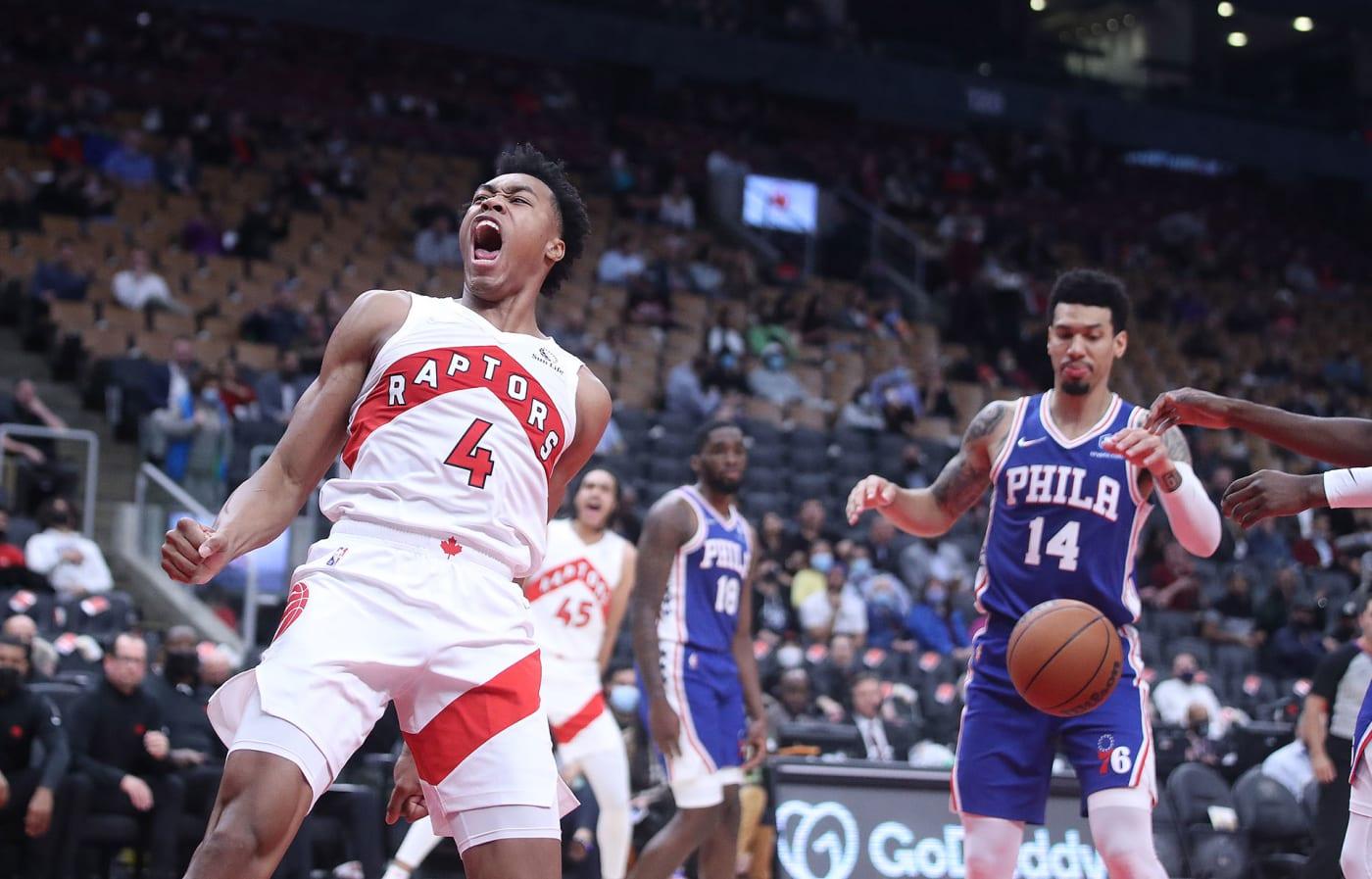Toronto Raptors forward Scottie Barnes (4) celebrates a dunk as the Toronto Raptors play the Philadelphia 76ers in preseason action in Toronto. October 4, 2021.