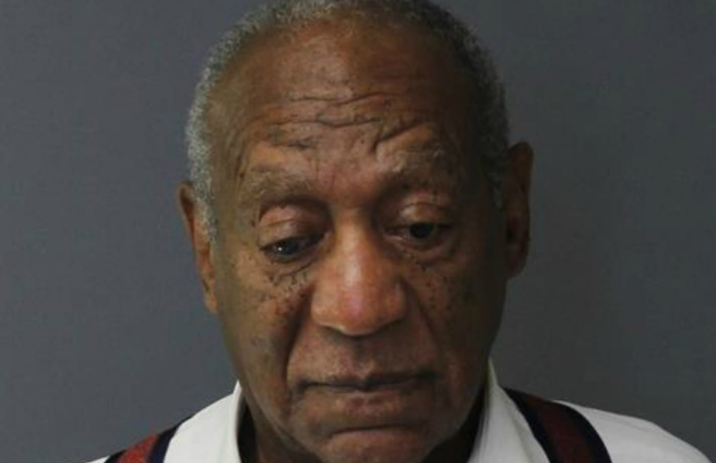 Bill Cosby poses for a mugshot