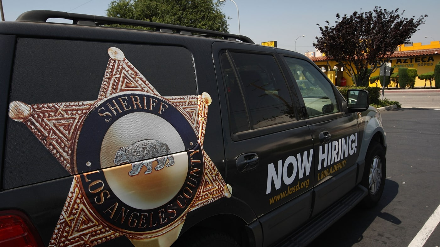 Los Angeles County sheriffs vehicle that advertises for recruits is parked in the parking lot.