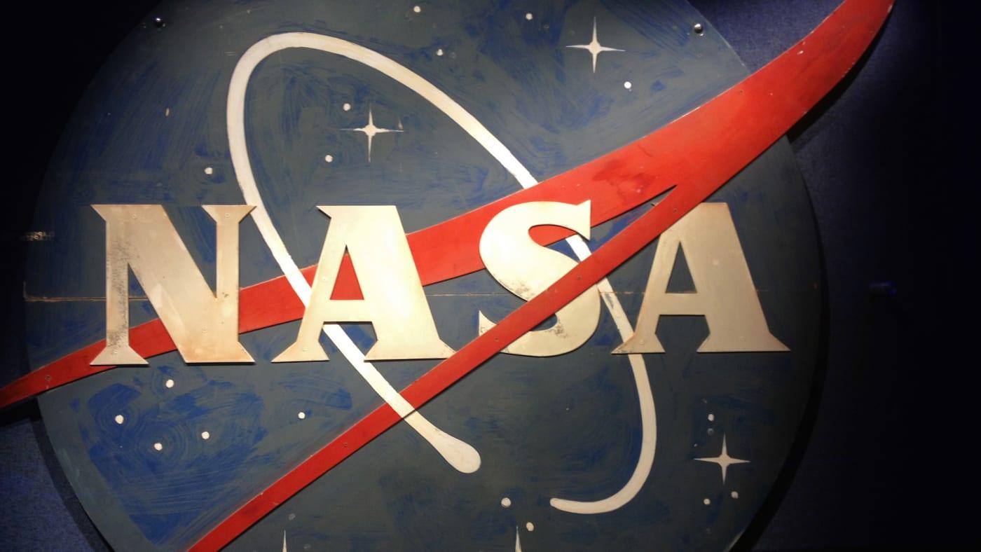 NASA logo hangs on a wall