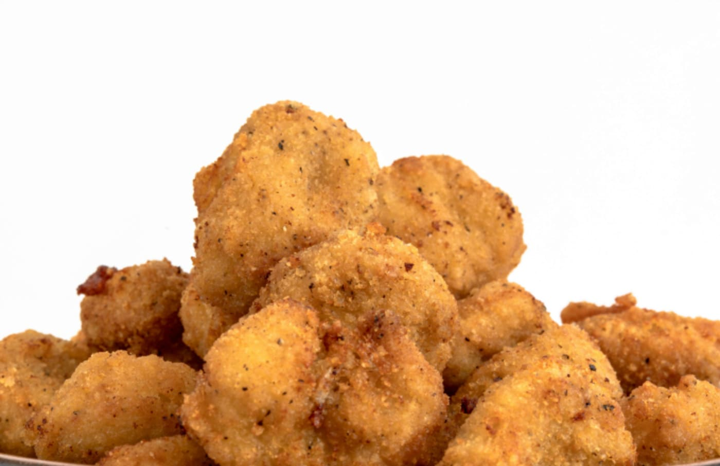 Close up of Chicken Nuggets over a white background