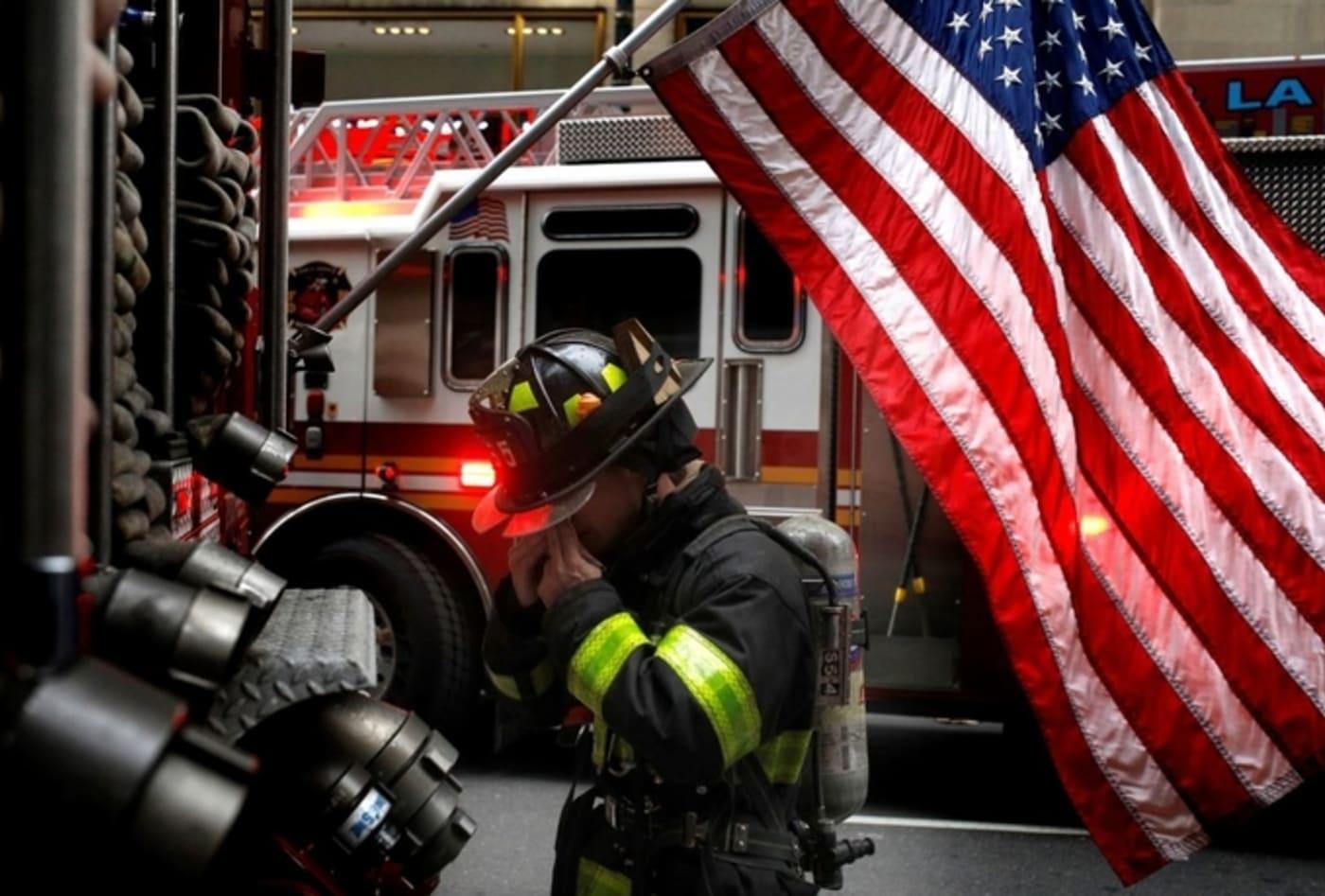 A member of New York City Fire Department is seen after a fire broke