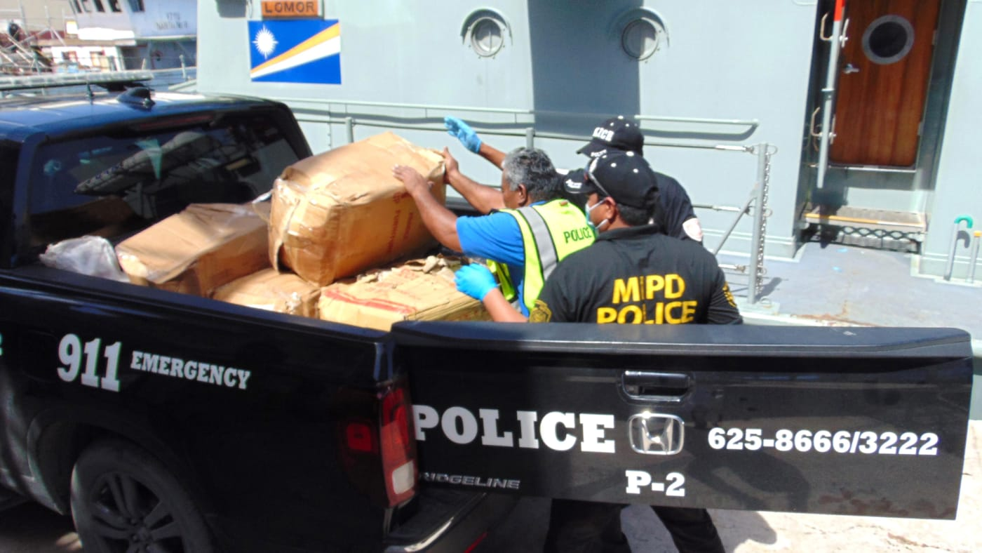 Police loading cocaine into truck