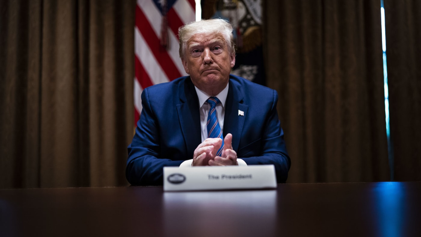U.S. President Donald Trump listens during a roundtable