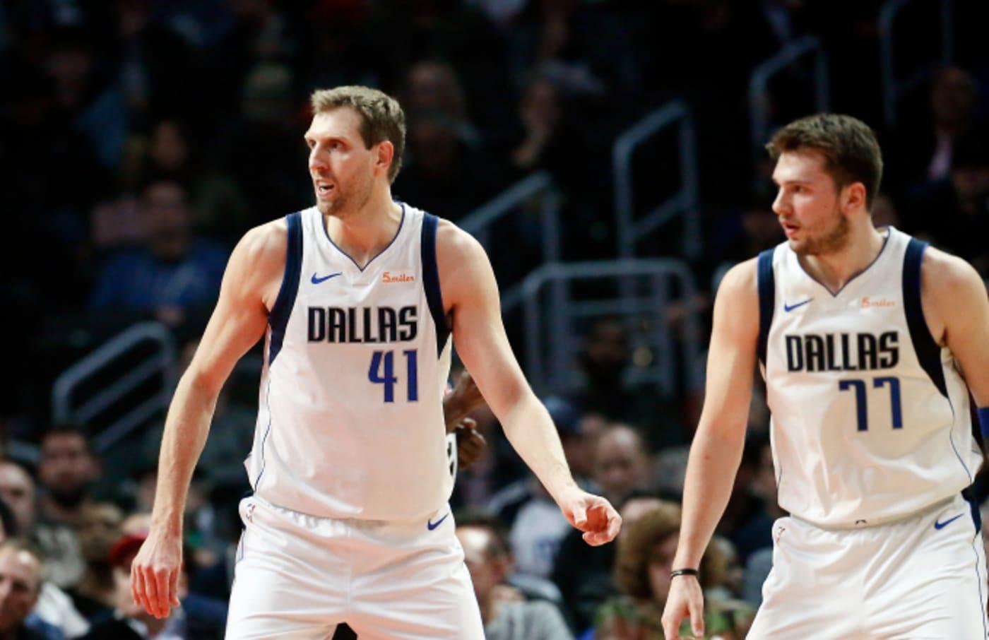 Dirk Nowitzki #41, and Luka Doncic #77 of the Dallas Mavericks