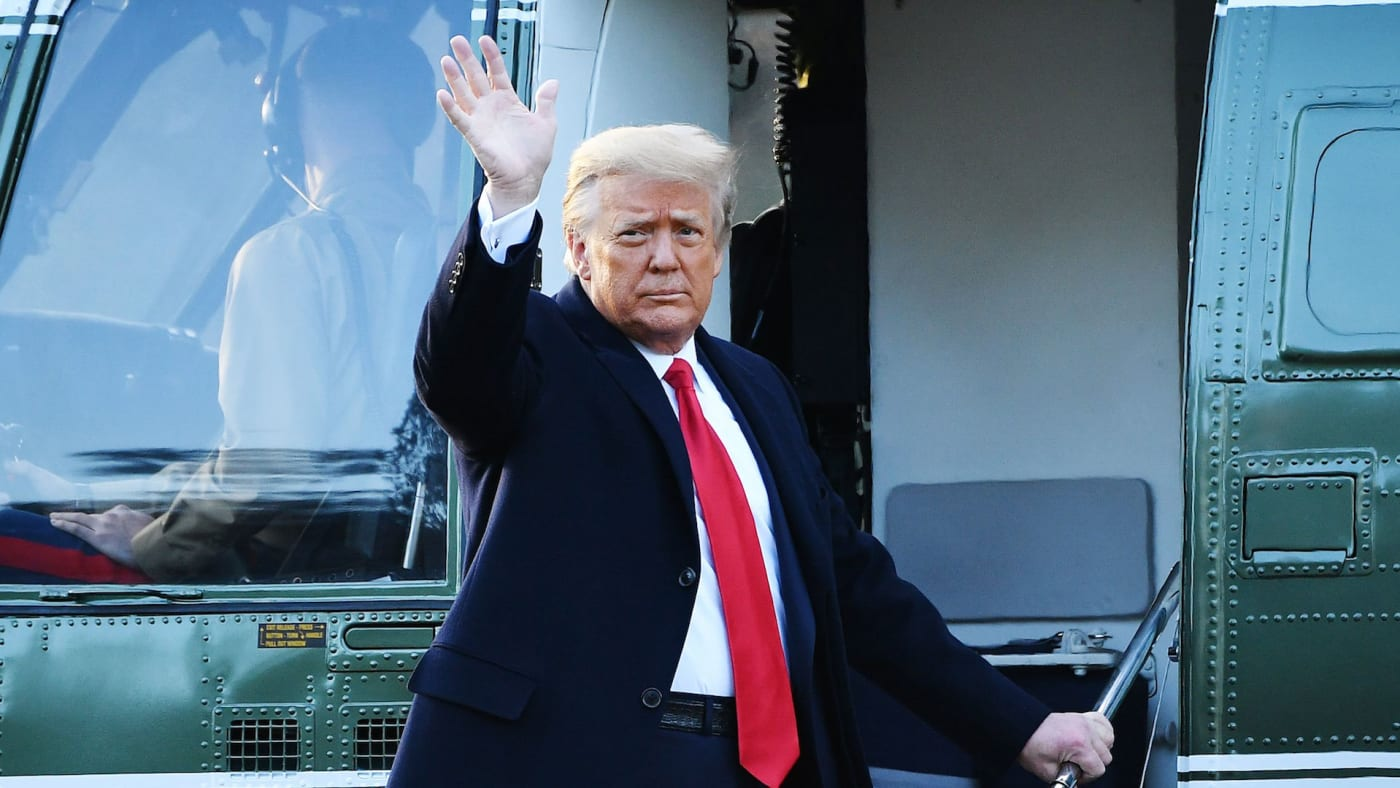 Outgoing US President Donald Trump waves