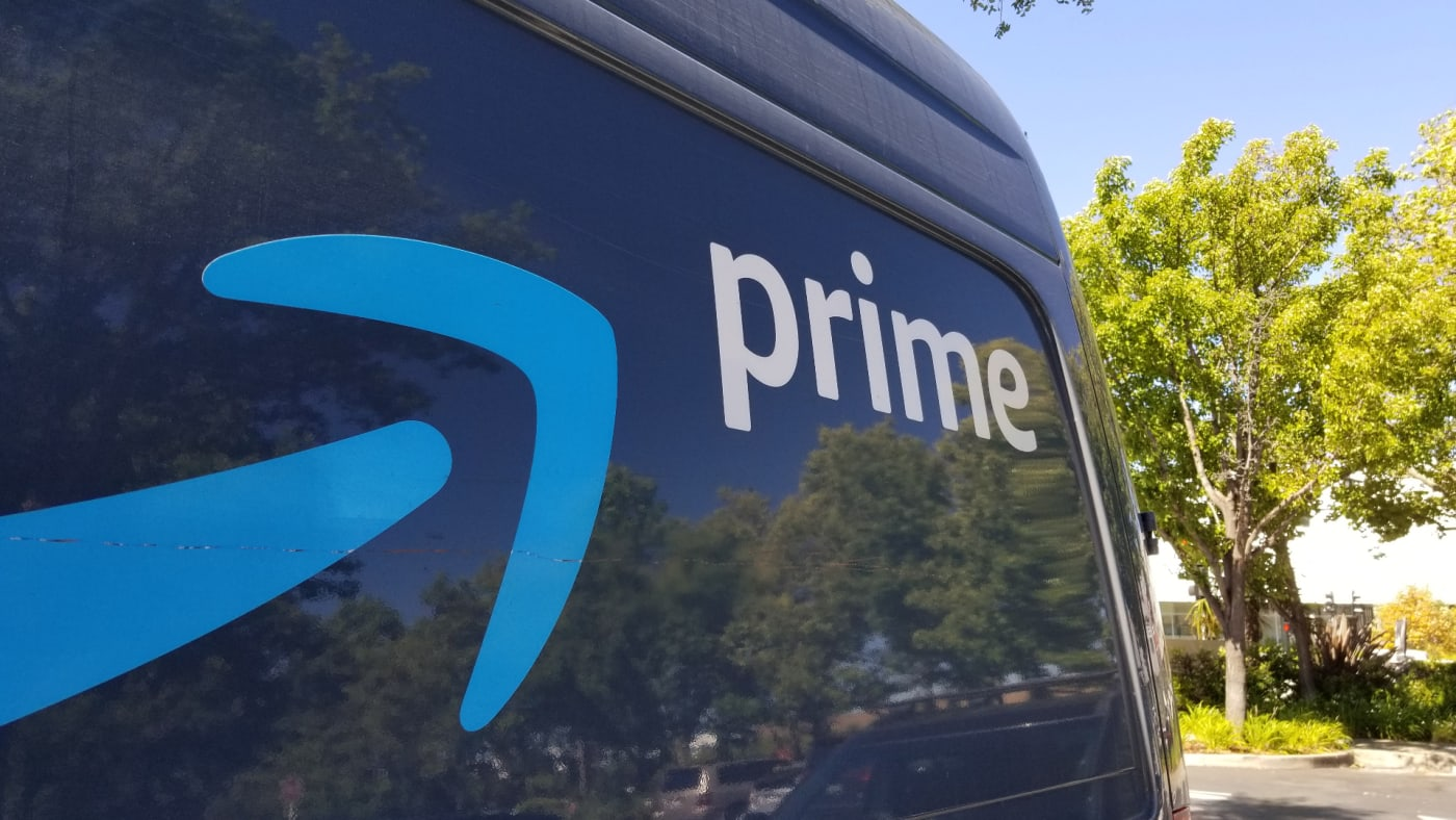 Close-up of logo for Amazon Prime service on the side of a branded delivery truck.