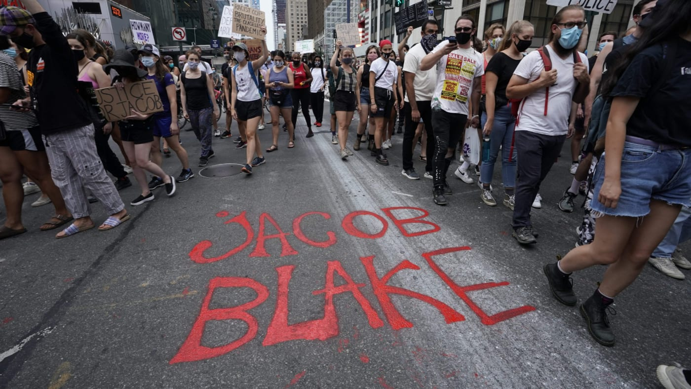 Demonstrators march during a protest in New York against the shooting of Jacob Blake.